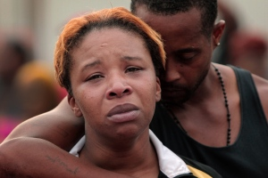 Aug 9, 2014 - Ferguson, Missouri, U.S. - LESLEY MCSPADDEN is comforted by her husband, Louis Head, hours after the fatal police shooting of her son Michael Brown in the Canfield Green Apartments. (Credit Image: © Huy Mach/St Louis Post-Dispatch/ZUMAPRESS.com)