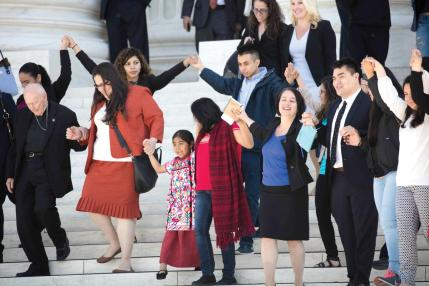 April 18, 2016 - Washington, DC, United States of America - Supporters of fair immigration reform join hands as they leave together after oral arguments at the Supreme Court in the case U.S. versus Texas on Monday, April 18, 2016 in Washington D.C. They defended the legality of President Obama's executive actions aimed at granting quasi-legal status and work permits to up to 5 million people who entered the U.S. illegally as children or who have children who are American citizens. (Photo by Jeff Malet) (Credit Image: © Jeff Malet/Newscom via ZUMA Press)