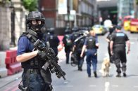 June 4, 2017 - London, UK - Armed police on St Thomas Street, London, near the scene of last night's terrorist incident at Borough Market. (Credit Image: © Dominic Lipinski/PA Wire via ZUMA Press)