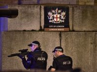June 3, 2017 - London, United Kingdom - Armed Police officer looks through his weapon on London Bridge. Police shut down the bridge Saturday evening after a white van mounted the sidewalk and mowed down pedestrians. The authorities said there were casualties on the bridge, with more than one person dead. (Credit Image: © Dominic Lipinski/PA Wire via ZUMA Press)