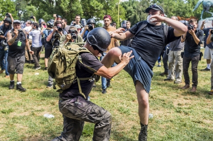 August 12, 2017 - Charlottesville, Virginia, U.S. - White supremacist groups clashed with hundreds of counter-protesters during the ''Unite The Right'' rally in Charlottesville, Va. Dozens were injured in skirmishes and many others after a white nationalist plowed his sports car into a throng of protesters. One counter-protester died after being struck by the vehicle. The driver of the car was caught fleeing the scene and the Governor of Virginia issued a state of emergency. (Credit Image: © Michael Nigro/Pacific Press via ZUMA Wire)