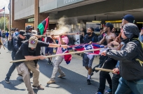 August 12, 2017 - Charlottesville, Virginia, U.S. - Police pepper sprays a protestor as a group takes a confederate flag from rally participants as white supremacist groups clashed with hundreds of counter-protesters during the 'Unite The Right' rally in Charlottesville. Dozens were injured in skirmishes and many others after a white nationalist plowed his sports car into a throng of protesters. (Credit Image: © Michael Nigro/Pacific Press via ZUMA Wire)